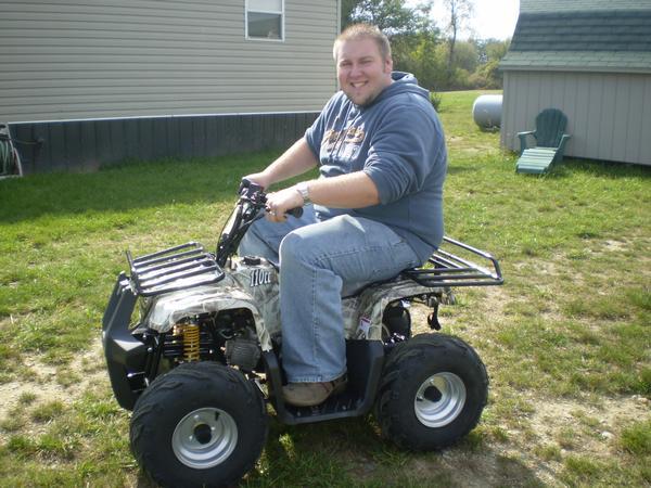 Adult riding a 90cc atv - ATVConnection com ATV Enthusiast